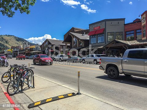Jackson, Wyoming. Street with old houses, bicycles and cars