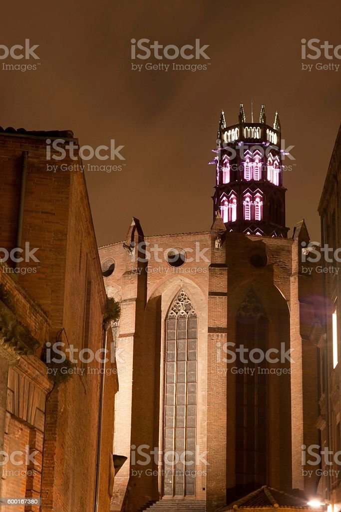 Jacobinos convent at night with pink lights in Toulouse, France stock photo
