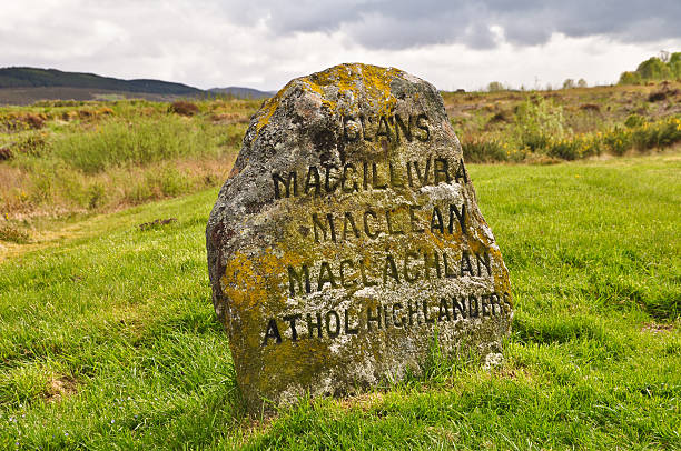 Jacobite Gravestone at Culloden, Scotland Taken on the battlefield of Culloden in Inverness Scotland. A headstone marks the area where several Jacobite clans died in the Battle of Culloden 1746 against the British. culloden stock pictures, royalty-free photos & images