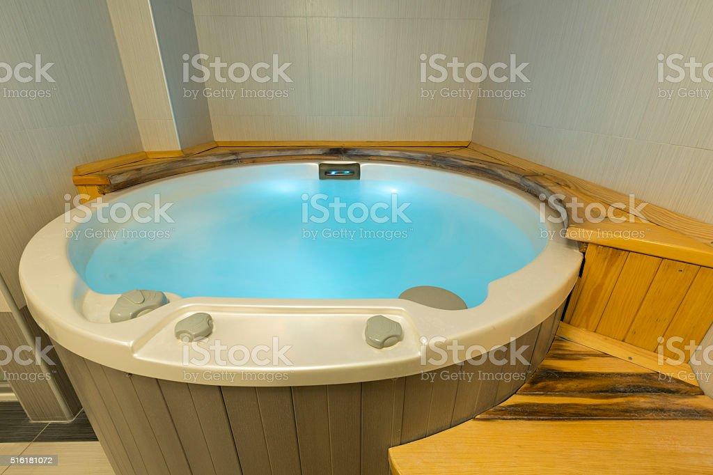 Jacuzzi bath in spa wellness center stock photo