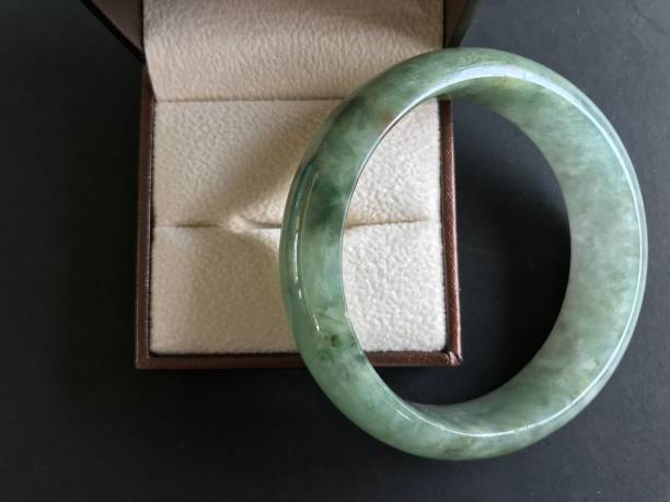 Jade bracelet and diamond in the box stock photo