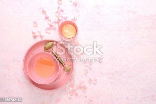 istock Jade roller spa treatment concept 1139732160