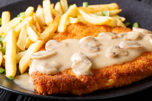 jaeger schnitzel with french fries and mushrooms macro. horizontal - escalope imagens e fotografias de stock