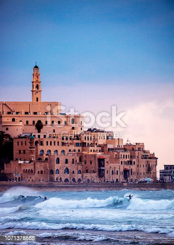 Jaffa sunset, surfers in action. Tel Aviv, Israel