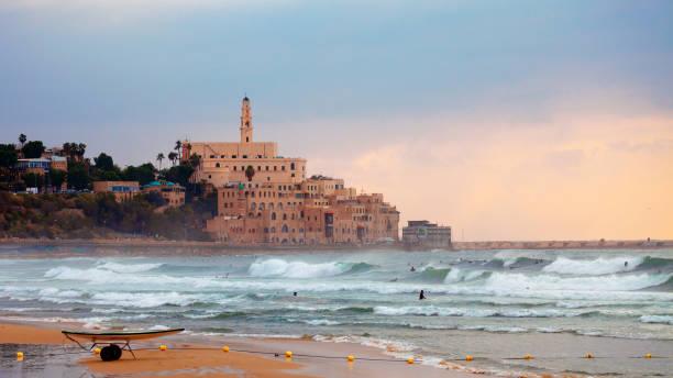 Jaffa sunset, surfers in action - Tel Aviv, Israel stock photo