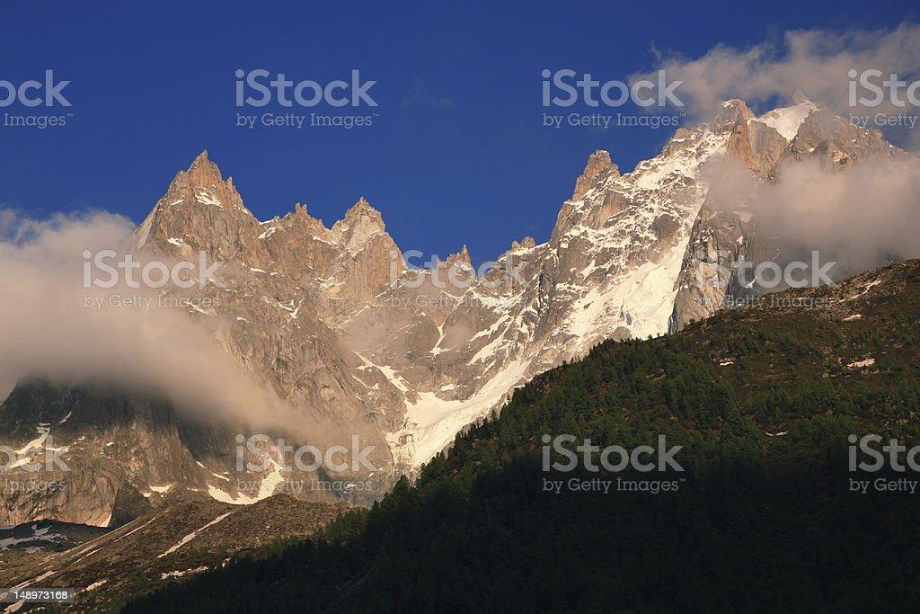 Jagged alpine summits in evening light royalty-free stock photo
