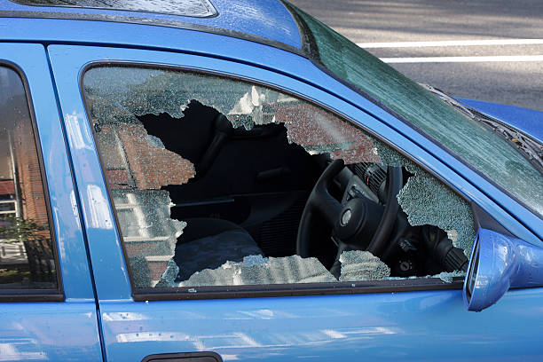 Window smashed by car thief street scene A jagged black hole with cracked and crazed glass reveals the workings of a thief in the night, during the morning after. One more car crime on the streets of London. whiteway stock pictures, royalty-free photos & images