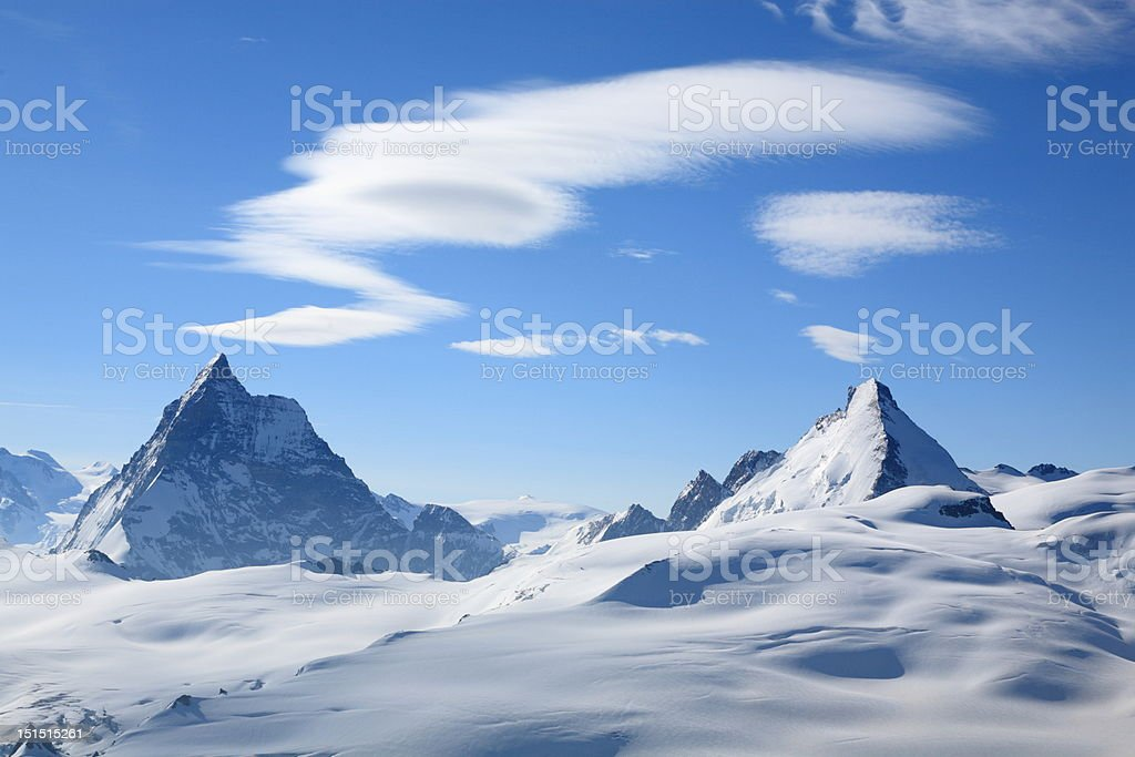 Jagged mountains and cloud patterns royalty-free stock photo
