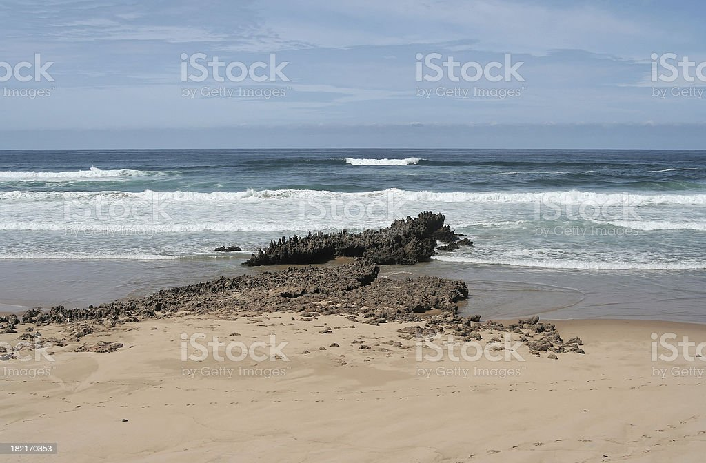 Jagged rock in the water stock photo