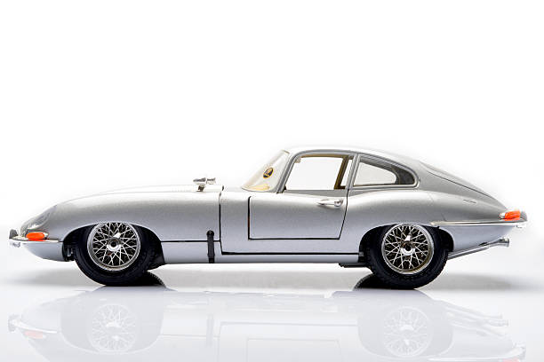 Jaguar E-Type Kampen, The Netherlands - March 25, 2014: Jaguar E-Type classic sports car model by Bburago isolated on a white background. jaguar car stock pictures, royalty-free photos & images