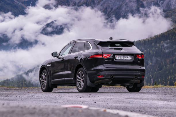 Jaguar F-Pace 3.0 V6 Salzburg, Austria - October 3, 2017: Jaguar F-Pace travels across Austria to Italy. Image taken on roads in the Alps mountains. The Jaguar F‑Pace is a performance SUV that combines maximum driving exhilaration with efficiency.  It features the responsive 2.0 litre 4-cylinder 250 hp Turbocharged Petrol, a new, more powerful 2.0 litre 4-cylinder 300 hp Turbocharged Petrol, and the high-powered 3.0 litre V6 340 hp Supercharged Petrol. jaguar car stock pictures, royalty-free photos & images