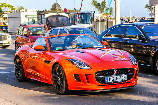 Jaguar F-Type Cannes, France - August 3, 2014: Motor car Jaguar F-Type drives in the city street. jaguar car stock pictures, royalty-free photos & images