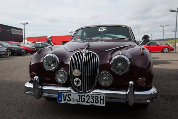 Jaguar Stuttgart, Germany - November 04, 2017: Amazing car 1960 Jaguar 3.8 Mark 2 parked between other cars in Stuttgart - Germany. jaguar xj stock pictures, royalty-free photos & images