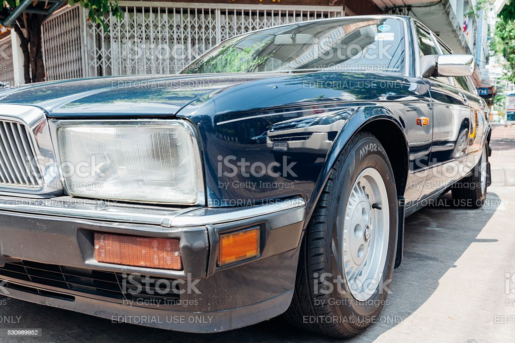 Jaguar Sovereign parked on the street of Bangkok stock photo