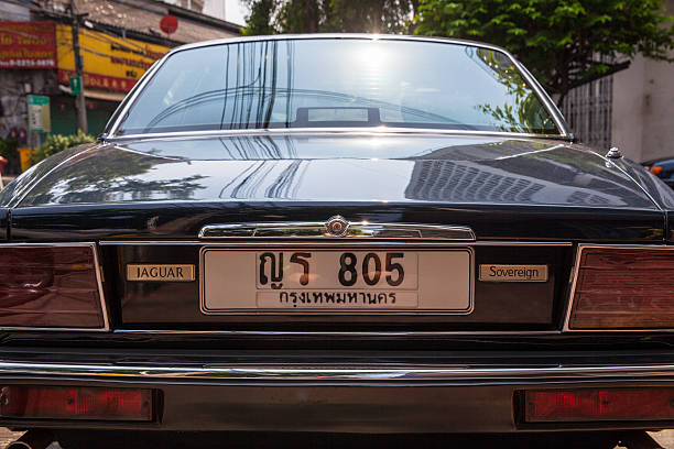 Jaguar Sovereign parked on the street of Bangkok Bangkok, Thailand - April 24, 2016: Jaguar Sovereign parked on the street of Bangkok. jaguar xj stock pictures, royalty-free photos & images