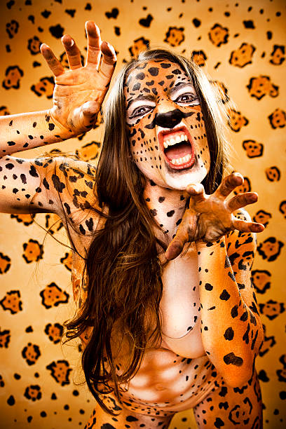 jaguar woman on the prowl - naked women with animals stock photos and pictures