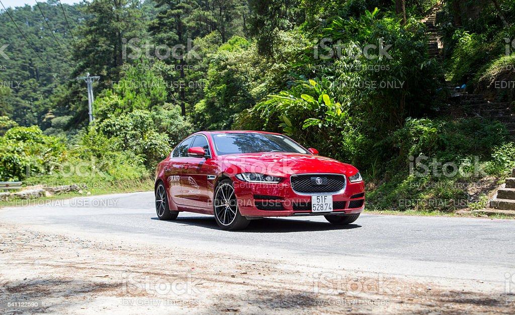 Jaguar XE 2016 car Tamdao, Vietnam - Jun 14, 2016: Jaguar XE 2016 car is at the test drive on mountain road in Vietnam. 2016 Stock Photo