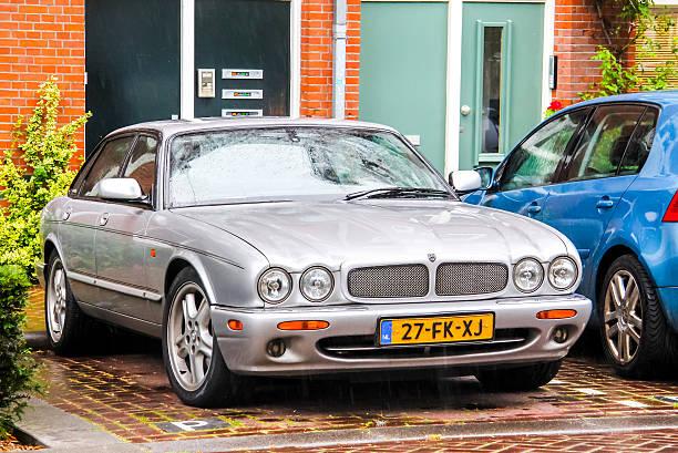 Jaguar XJ Amsterdam, Netherlands - August 10, 2014: Motor car Jaguar XJ is parked at the city street. jaguar xj stock pictures, royalty-free photos & images