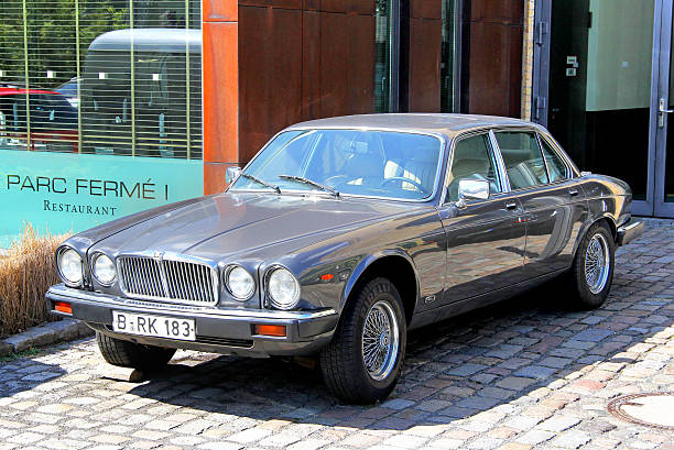 Jaguar XJ Berlin, Germany - August 12, 2014: Classic british sedan Jaguar XJ is parked in the city street near the museum of vintage cars Classic Remise. jaguar xj stock pictures, royalty-free photos & images