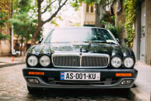 Jaguar Xj (X308) Sedan Car Parked In Street.  Jaguar XJ X308 Is Tbilisi, Georgia - October 22, 2016:  The Jaguar XJ (X308) Sedan Car Parked In Street.  Jaguar Xj X308 Is A Luxury Saloon Manufactured And Sold By Jaguar Cars Between 1997 And 2003. jaguar xj stock pictures, royalty-free photos & images