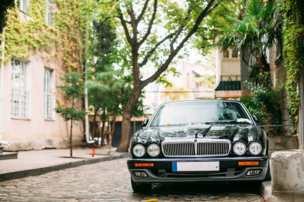 Jaguar Xj X308 Sedan Car Parked In Street. Jaguar XJ X308 Is A Luxury Saloon Manufactured And Sold By Jaguar Cars Between 1997 And 2003 Tbilisi, Georgia - October 22, 2016: The Jaguar XJ X308 Sedan Car Parked In Street. Jaguar Xj X308 Is A Luxury Saloon Manufactured And Sold By Jaguar Cars Between 1997 And 2003. jaguar xj stock pictures, royalty-free photos & images