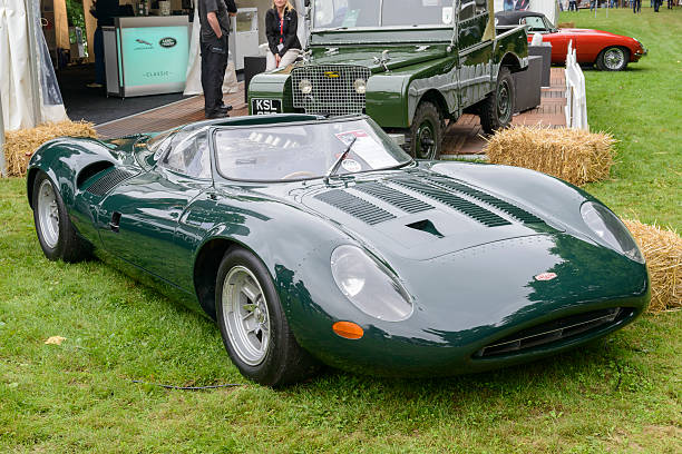 Jaguar XJ13 1960s Le Mans race car prototype Jüchen, Germany - August 5, 2016: Jaguar XJ13 1960s Le Mans race car prototype. The Jaguar XJ13 was a prototype racing car developed by Jaguar to challenge at Le Mans in the mid 1960s. This is the only one of its kind in existence. The car is on display during the 2016 Classic Days at castle Dyck. The car is displayed in a field, with people looking at the cars in the background. jaguar xj stock pictures, royalty-free photos & images