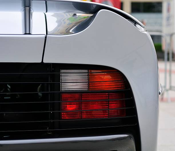 Jaguar XJ220 Eindhoven, The Netherlands - June 7, 2008: Rear light on a silver Jaguar XJ220 super car. The Jaguar XJ220 is a mid-engined supercar produced by Jaguar in collaboration with Tom Walkinshaw Racing as Jaguar Sport between 1992 and 1994. jaguar xj stock pictures, royalty-free photos & images