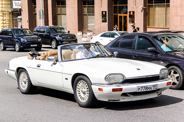 Jaguar XJ-S Moscow, Russia - June 2, 2013: Motor car Jaguar XJ-S drives in the city street. jaguar xj stock pictures, royalty-free photos & images