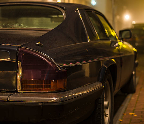 Jaguar XJ-S sports car at night Kampen, The Netherlands - November 2, 2015: Jaguar XJ-S sports car parked at the side of a street at night. The Jaguar XJ-S or XJS later, is a luxury grand tourer sports car produced by British manufacturer Jaguar from 1976 to 1996. jaguar xj stock pictures, royalty-free photos & images