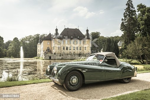 Jaguar XK 120 classic sports car in front of Schloss Dyck. The car is on display during the 2014 Classic Days event at Schloss Dyck.
