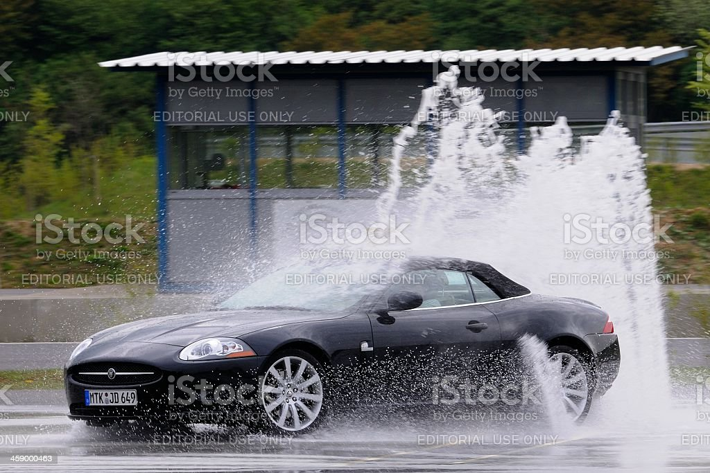 Jaguar XKR skidding stock photo