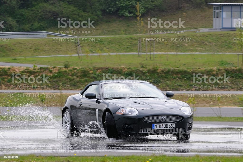 Jaguar XKR skidding stock photo