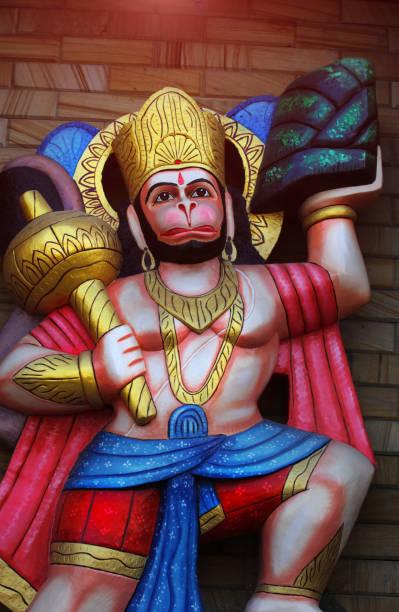 Jai Hanuman Hindu God jai hanuman statue, hanuman is carrying mountains in his hands. hanuman stock pictures, royalty-free photos & images