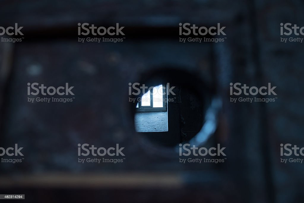 Jailer's eye-view into a prison cell stock photo