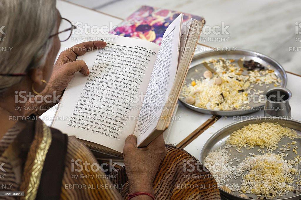 Jain devotee reading scripture, Ajmer, Rajasthan, India. stock photo
