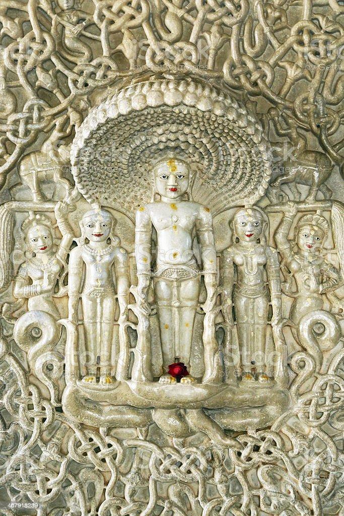 Jainist gods in bas-relief of Ranakpur, India stock photo
