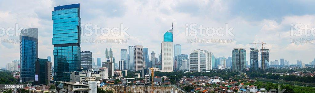 Jakarta downtown skyline buildings at sunset, big size panorama stock photo