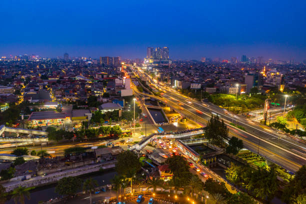 Jakarta flyover highway and Bus Rapid transit at night, Indonesia Jakarta, Indonesia - August 20, 2018: view showing Jakarta flyover highway and Bus Rapid transit at night bus rapid transit stock pictures, royalty-free photos & images