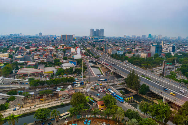Jakarta flyover highway and Bus Rapid transit, Indonesia Jakarta, Indonesia - August 20, 2018: view showing Jakarta flyover highway and Bus Rapid transit bus rapid transit stock pictures, royalty-free photos & images