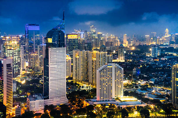 Jakarta skyline at dusk Jakarta skyline at dusk indonesia stock pictures, royalty-free photos & images