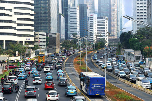 Jakarta traffic on Jendral Sudirman street Jakarta traffic in rush hour during weekday bus rapid transit stock pictures, royalty-free photos & images