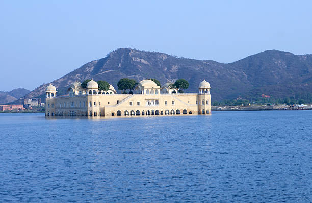"Jal Mahal, Jaipur, India ""Jal Mahal (lake Palace)  is a palace located in the middle of the Man Sagar Lake in Jaipur city, the capital of the state of Rajasthan, India.photo taken at sunset"" lake palace stock pictures, royalty-free photos & images"
