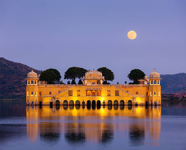 Jal Mahal (Water Palace).  Jaipur, Rajasthan, India Rajasthan landmark - Jal Mahal (Water Palace) on Man Sagar Lake in the evening in twilight.  Jaipur, Rajasthan, India udaipur stock pictures, royalty-free photos & images