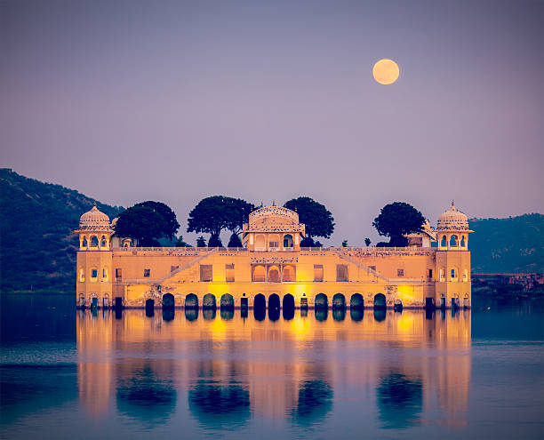 Jal Mahal (Water Palace).  Jaipur, Rajasthan, India Vintage retro hipster style travel image of Rajasthan landmark - Jal Mahal (Water Palace) on Man Sagar Lake in the evening in twilight.  Jaipur, Rajasthan, India udaipur stock pictures, royalty-free photos & images