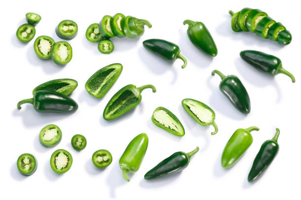 Jalapeno chiles whole sliced chopped, top, paths Jalapeno chile pepper (Capsicum annuum fruits), whole, chopped, halved, and sliced pods, top view, isolated jalapeno pepper stock pictures, royalty-free photos & images