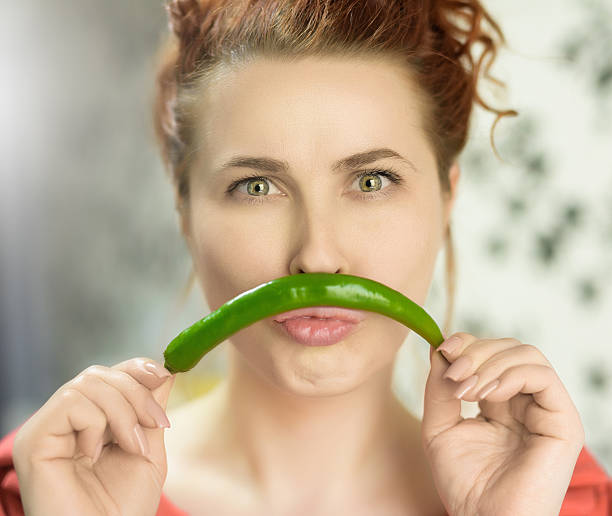jalapeno pepper portrait - woman green eyes red hair stock photos and pictures