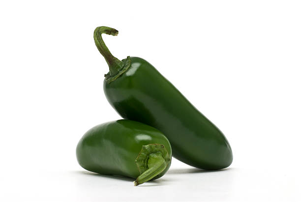 Jalapeno Peppers A pair of perfectly fresh jalapeno peppers isolated on white.Click on the banner below to see more photos like this. jalapeno pepper stock pictures, royalty-free photos & images