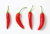 four mexican jalapeno peppers isolated on white background