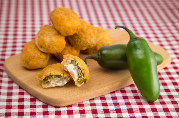 Jalapeno Poppers on a Red Gingham Tablecloth Jalapeno Poppers on a Red Gingham Tablecloth jalapeno pepper stock pictures, royalty-free photos & images