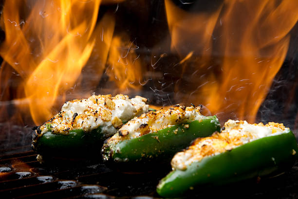 Jalapeno Poppers on Grill with Fire stock photo